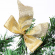 Decoration golden billow on new year tree branch — Stockfoto