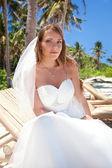 Beautiful bride on tropical beach — Stock Photo