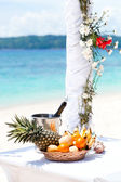 Beautiful wedding arch on tropical beach, focus on bottle — Stok fotoğraf