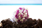 Bridal bouquet in rocks — Stock Photo