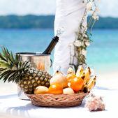 Beautiful wedding arch on tropical beach — Stock Photo