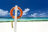Lifebuoy ring on beach — Stock Photo