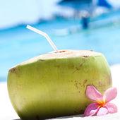 Tropical fresh cocktail on white beach — Stock Photo