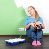 Unhappy woman with paint tools — Stock Photo