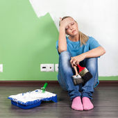 Tired woman with paint tools — Stock Photo