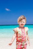 Happy little girl on the beach — Stock Photo