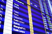 Flight information board in airport. — Stock Photo