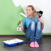 Young woman with paint tools — Stock Photo