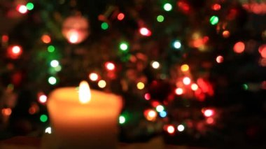 Burning candle on blinking lights background — 图库视频影像