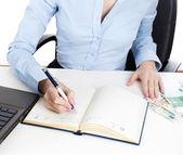 Businesswoman writing in organizer — Stock Photo