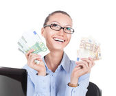 Smilling businesswoman  with euros in hands — Stock Photo