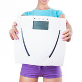 Diet and sport concept -  woman shows scale — Stock Photo