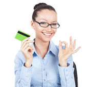 Smilling businesswoman with credit card in hand — Stock Photo
