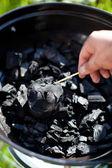 Lighting a matchstick, burn up a coal — Stock Photo