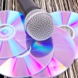 Microphone and compact disks on vinyl records — Stock Photo #4747122