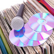 Microphone and compact disks on records — Stock Photo #4747123