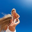 Happy mother and little child on beach — Stock Photo #50002277
