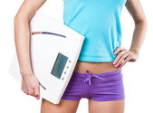 Diet and sport concept -  woman with scale — Stock Photo