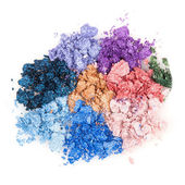 Flower made of crumbled makeup eyeshadows — Stock Photo