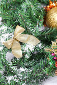 Decoration golden billow on new year tree branch — Stock Photo