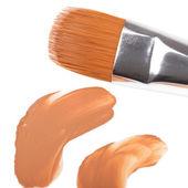 Make-up neilon brush with foundation — Стоковое фото