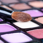 Make-up eye shadows palette with makeup brush — Stock Photo