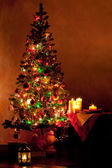 Lighted Christmas tree in living room — Stock Photo