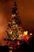 Lighted decorated Christmas tree in living room — Stock Photo