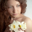 Woman with narcissus — Stock Photo