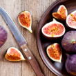 Plate with fresh figs and old knife — Stock Photo #12782597