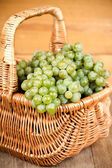 Basket with fresh green grapes — Stock Photo