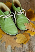 Boots and yellow leaves — Stock Photo