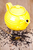 Yellow teapot with spoon — Stock Photo