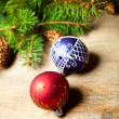 Christmas fir tree with pinecones and decorations — Stock Photo