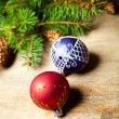 Christmas fir tree with pinecones and decorations - Stock Photo