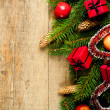 Fir tree with pinecones, apples and decorations -  