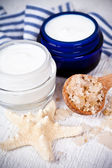 Face cream in jars with sea salt and star — Stockfoto