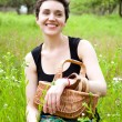 Woman with basket in the garden — Stock Photo #23419670