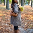 Woman in autumn park — Stock Photo #27924021