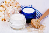 Face cream in jars with sea salt and shell — Stok fotoğraf