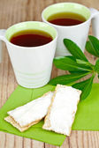 Tea and crackers with cream cheese — Stock Photo