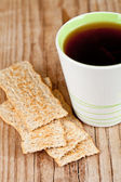 Cup of tea and crackers — Stock Photo