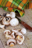 Fresh champignons and old knife — Stock Photo