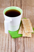 Cup of tea and crackers for breakfast — Stock Photo