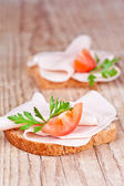 Bread with sliced ham, fresh tomatoes and parsley — Stock Photo