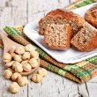 Sliced fresh buns hazelnuts in spoon — Stock Photo