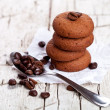 Chocolate cookies and spoon with coffee beans — Stock Photo