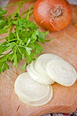 Fresh onions and parsley — Stock Photo
