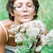 Brunet woman in a meadow — Stock Photo #3753108