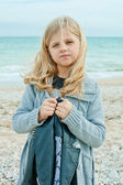 Girl at the autumn beach — Stock Photo